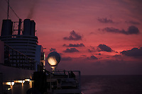 Dawn Aboard the Semester at Sea M/V Explorer in the Gulf of Mexico off the Coast of Guatemala. Image taken with a Nikon D3s and 70-300 mm VR lens (ISO 1600, 70 mm, f/4.5, 1/125 sec).