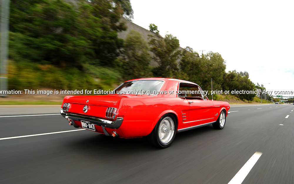 1966 Ford Mustang Coupe - Signalflare Red.Pirotta Motors, Springvale, Victoria.3rd December 2011.(C) Joel Strickland Photographics..Use information: This image is intended for Editorial use only (e.g. news or commentary, print or electronic). Any commercial or promotional use requires additional clearance.
