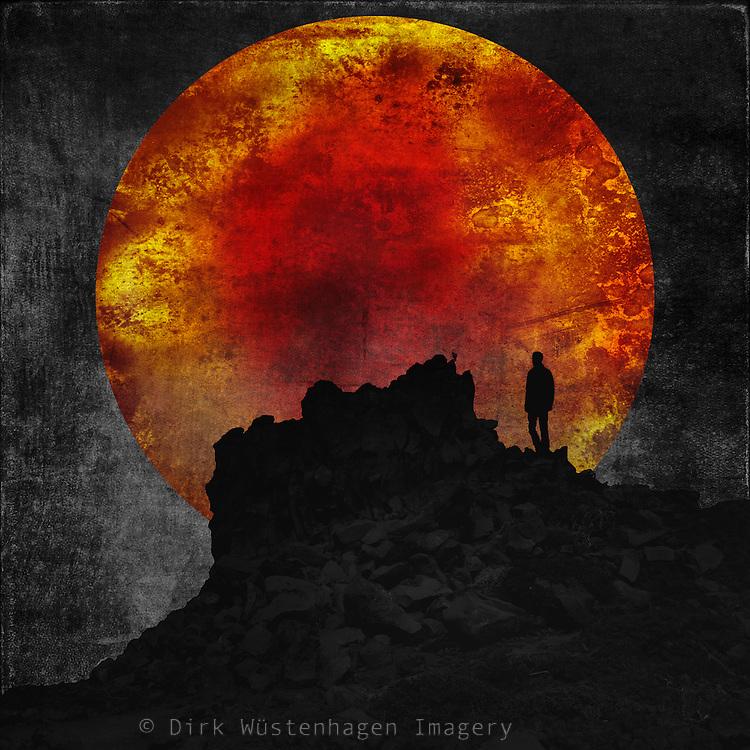 Photomanipulation - man on a rock with huge sun