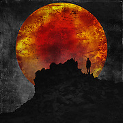 Photomanipulation - man on a rock with huge sun