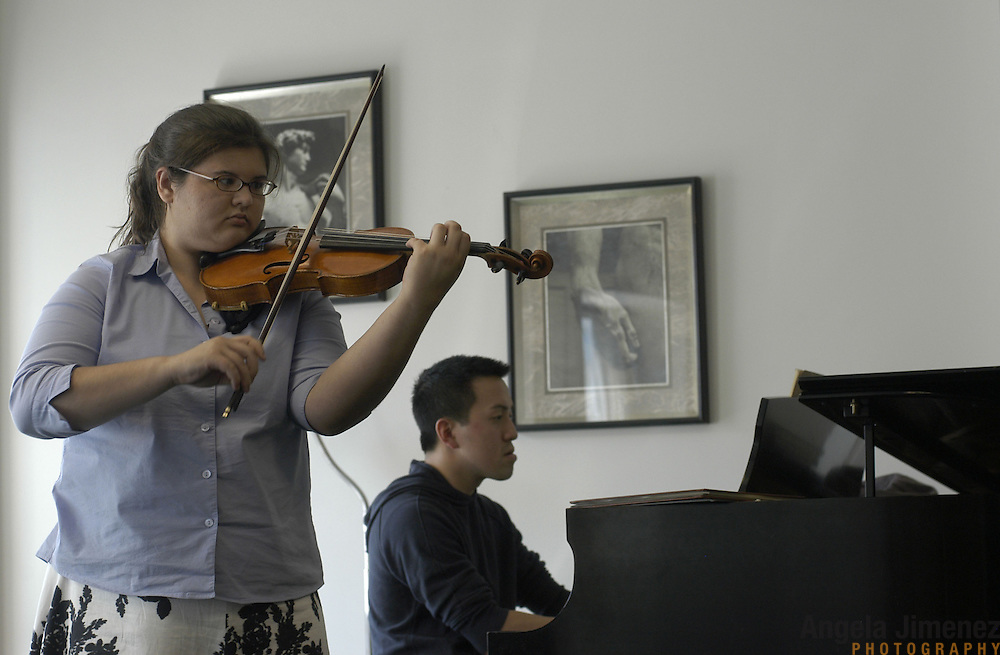 """Violinist Elizabeth """"Libby"""" Fayette of Long Island, New York, 17, left, accompanied by Paul Kwak on the piano, plays during her weekly private lesson in the Pre-College Division program at The Juilliard School, located at West 65th Street and Broadway in New York City, on Saturday, September 24, 2005. Students audition for spots in the prestigious program, in which they can study until they graduate from high school."""