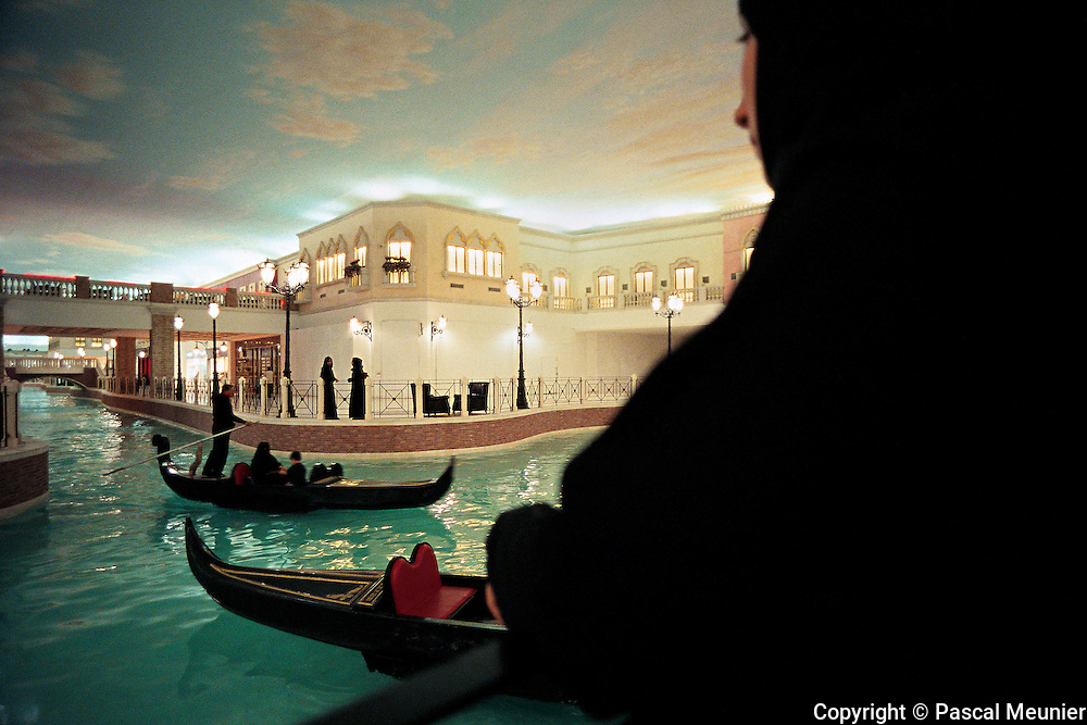 QATAR. Doha. Villaggio mall...Venice scenery in the new shopping mall, Villaggio. Gondoliers carry families, while the girls spend some time amongst themselves.