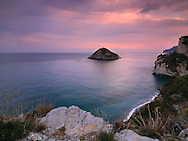 A view at sunset of the cliffs of the Ligurian coast near Bergeggi. Stitched from four vertical frames.