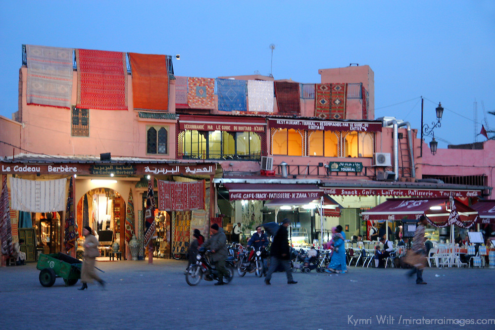 North Africa, Africa, Morocco, Marrakesh. Cafes and carpets line the square at the Djeema el Fna in Marrakesh.