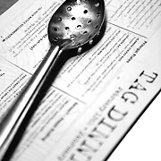 """SHOT 2/17/12 7:20:15 PM - A slotted spoon on a dinner menu at TAG  restaurant on Larimer Square in downtown Denver, Co. The restaurant is operated by chef/owner Troy Guard. TAG features what they term """"continental social food"""" and features influences from numerous continents. .(Photo by Marc Piscotty / © 2012)"""
