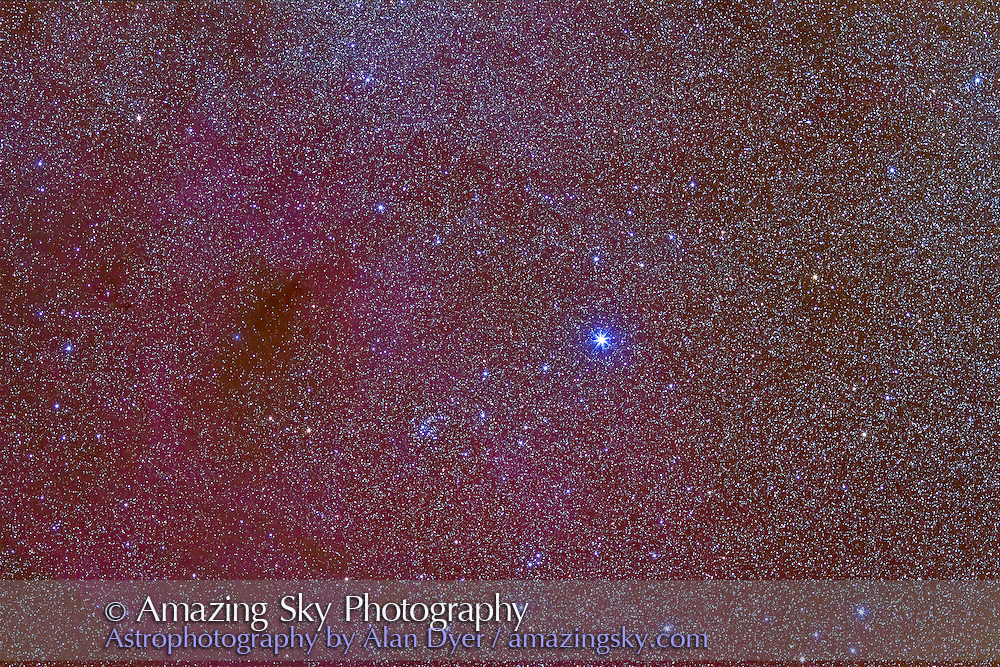 NGC 2547, the Gamma Velorum Cluster in Vela. The bright star is Regor or Gamma Velorum, a superhot blue giant star. Taken from Chile this is a stack of 5 x 2 minute exposures at f/2.8 with the 135mm lens and Canon 7D at ISO 1250. The field is oriented along the Milky Way, so north is at lower right here. The field is roughly the same as a binocular field of view.
