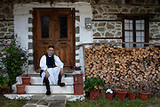 Thanasis Hatzis in front of his house. He is one of the most social and cheerful people in the village, proud for his dancing skills in traditional dances and he often gets together with his friends to sing traditional songs with the help of some local alcohol (tsipouro). He remembers how in the old times there were many festivals and people were walking from village to village to take part, dance and sing together.