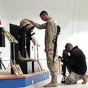 24 December 2004.Mosul, Iraq..Memorial service for the dead in mess hall attack...A suspected suicide bomb attack on the food hall at Forward Operating Base Marez in Mosul on the 21 December claimed the lives of 22 US forces, Iraqis and civillian contractors. Today 24 December the 133 Engineer Battalion held a memorial service for two of its fallen comrades; Sgt Lynn Poulin aged 47 and Specialist Thomas Dostie aged 20.