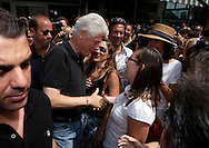 Former President Bill Clinton greets Times Herald-Record reporter Meghan Murphy as he leaves GiGi's Restaurant after lunching in Rhinebeck, NY on Friday, July 30, 2010. His daughter Chelsea Clinton will marry her longtime boyfriend, investment banker Marc Mezvinsky at a private estate on Saturday.