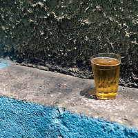 South America, Brazil. Rio de Janiero. A beer sits on ledge of croner at Favela of Vila Canoas.
