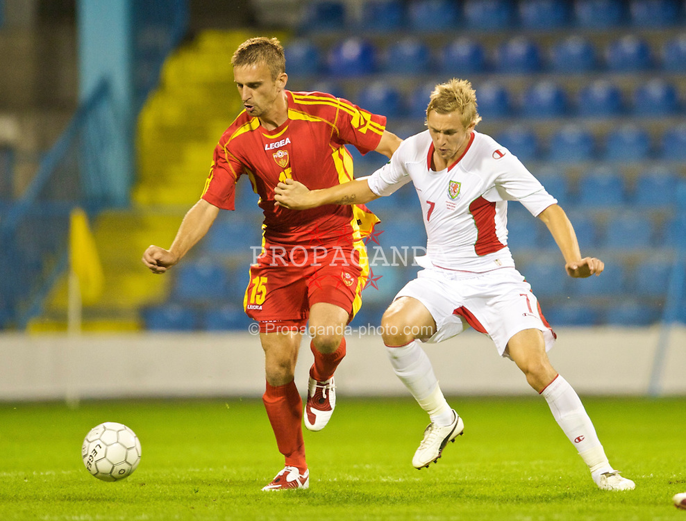 PODGORICA, MONTENEGRO - Wednesday, August 12, 2009: Wales' Jack Collison and Montenegro's Milorad Pekovic during an international friendly match at the Gradski Stadion. (Photo by David Rawcliffe/Propaganda)