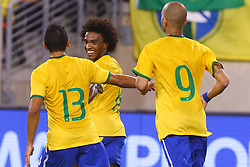 Sep 9, 2014; East Rutherford, NJ, USA; Brazil midfielder Willian (19) celebrates his goal during the first half at MetLife Stadium.