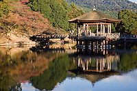 Ukimi-do is a hexagonal gazebo on the water built over Sage-Ike Pond or Heron Pond in Nara Park.  Its reflection on the water is a popular subject for artists and photographers. It is especially beautiful on summer nights, when it is illuminated, in autumn with reflection of maples and spring with sakura blossoms on the pond.