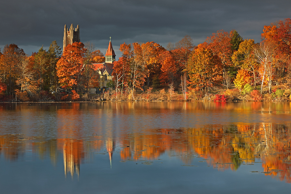 Wellesley College, featuring its iconic Galen Stone Tower which is part of Green Hall and the William S. Houghton Memorial Chapel on a beautiful afternoon in autumn. Fall foliage colors and the historic building are reflected in Lake Waban. Wellesley College is a private, women's, liberal-arts college located in the town of Wellesley, Massachusetts and it is ranked the third best liberal arts college in the United States. Notable alumnae include Hillary Clinton, Madeleine Albright, Soong Mei-ling, Cokie Roberts, and Diane Sawyer. It&rsquo;s most famous student is Hillary Rodham Clinton, Class of 1969. Hillary Rodham Clinton is currently running for president of the United States aiming to make history and becoming the first female US president. <br /> <br /> Wellesley College photography images are available as museum quality photography prints, canvas prints, acrylic prints or metal prints. Prints may be framed and matted to the individual liking and room decor needs:<br /> <br /> http://juergen-roth.pixels.com/featured/wellesley-college-juergen-roth.html<br /> <br /> Good light and happy photo making! <br /> <br /> My best, <br /> <br /> Juergen <br /> Image Licensing: http://www.RothGalleries.com <br /> Fine Art Prints: http://fineartamerica.com/profiles/juergen-roth.html <br /> Photo Blog: http://whereintheworldisjuergen.blogspot.com <br /> Twitter: https://twitter.com/naturefineart <br /> Facebook: https://www.facebook.com/naturefineart <br /> Instagram: https://www.instagram.com/rothgalleries