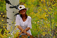 Woman on way to picnic in aspen grove, <br /> MODEL RELEASED
