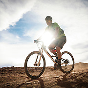 SHOT 10/14/16 4:05:36 PM - Mike Tryggestad of Denver, Co. bikes down Murphy's Hogback on the White Rim Trail. The White Rim is a mountain biking trip in Canyonlands National Park just outside of Moab, Utah. The White Rim Road is a 71.2-mile-long unpaved four-wheel drive road that traverses the top of the White Rim Sandstone formation below the Island in the Sky mesa of Canyonlands National Park in southern Utah in the United States. The road was constructed in the 1950s by the Atomic Energy Commission to provide access for individual prospectors intent on mining uranium deposits for use in nuclear weapons production during the Cold War. Four-wheel drive vehicles and mountain bikes are the most common modes of transport though horseback riding and hiking are also permitted.<br /> (Photo by Marc Piscotty / &copy; 2016)