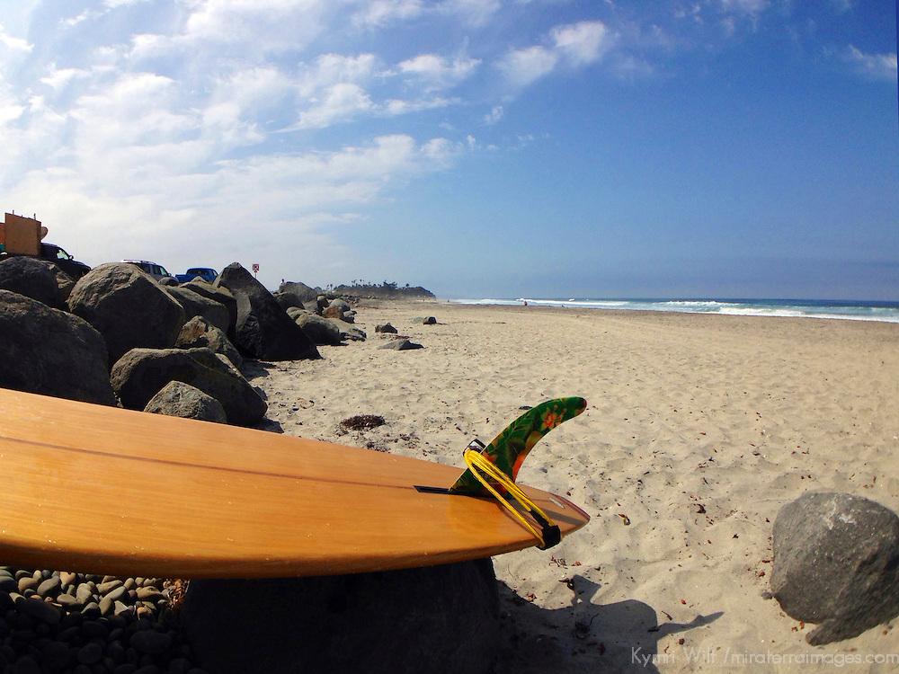 USA, California, Cardiff by the Sea. Longboard on Rocks.