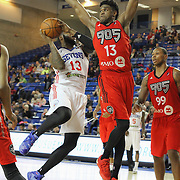 Delaware 87ers Forward DAVID LAURY (13) drives towards the basket as Raptors 905 Forward RONALD ROBERTS, JR. (13) defends in the first half of a NBA D-league regular season basketball game between the Delaware 87ers and the Raptors 905 Friday, Jan. 15, 2016. at The Bob Carpenter Sports Convocation Center in Newark, DEL.