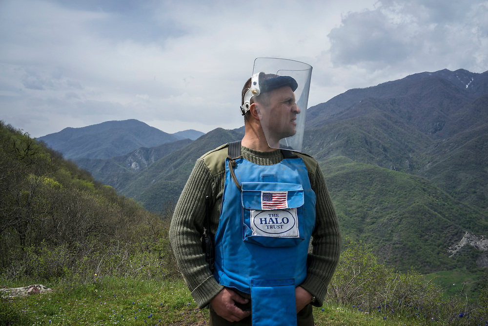 HAGOB KAMARI, NAGORNO-KARABAKH - APRIL 20: Rudik Sargsyan, commander of the charity HALO Trust's mine clearance team six, near some of the fields his team is currently clearing on April 20, 2015 in Hagob Kamari, Nagorno-Karabakh. Since signing a ceasefire in a war with Azerbaijan in 1994, Nagorno-Karabakh, officially part of Azerbaijan, has functioned as a self-declared independent republic and de facto part of Armenia, with hostilities along the line of contact between Nagorno-Karabakh and Azerbaijan occasionally flaring up and causing casualties. (Photo by Brendan Hoffman/Getty Images) *** Local Caption *** Rudik Sargsyan