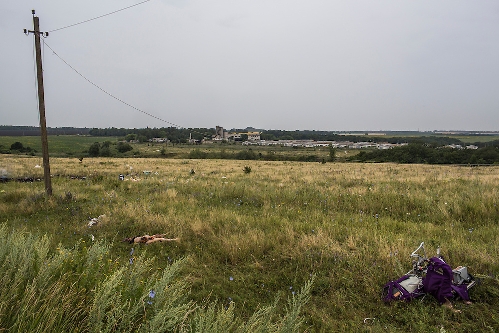 GRABOVO, UKRAINE - JULY 18: The bodies of victims of the crash of Malaysia Airlines flight MH17 lie in a field on July 18, 2014 in Grabovo, Ukraine. Malaysia Airlines flight MH17 travelling from Amsterdam to Kuala Lumpur has crashed on the Ukraine/Russia border near the town of Shaktersk. The Boeing 777 was carrying 280 passengers and 15 crew members. (Photo by Brendan Hoffman/Getty Images) *** Local Caption ***