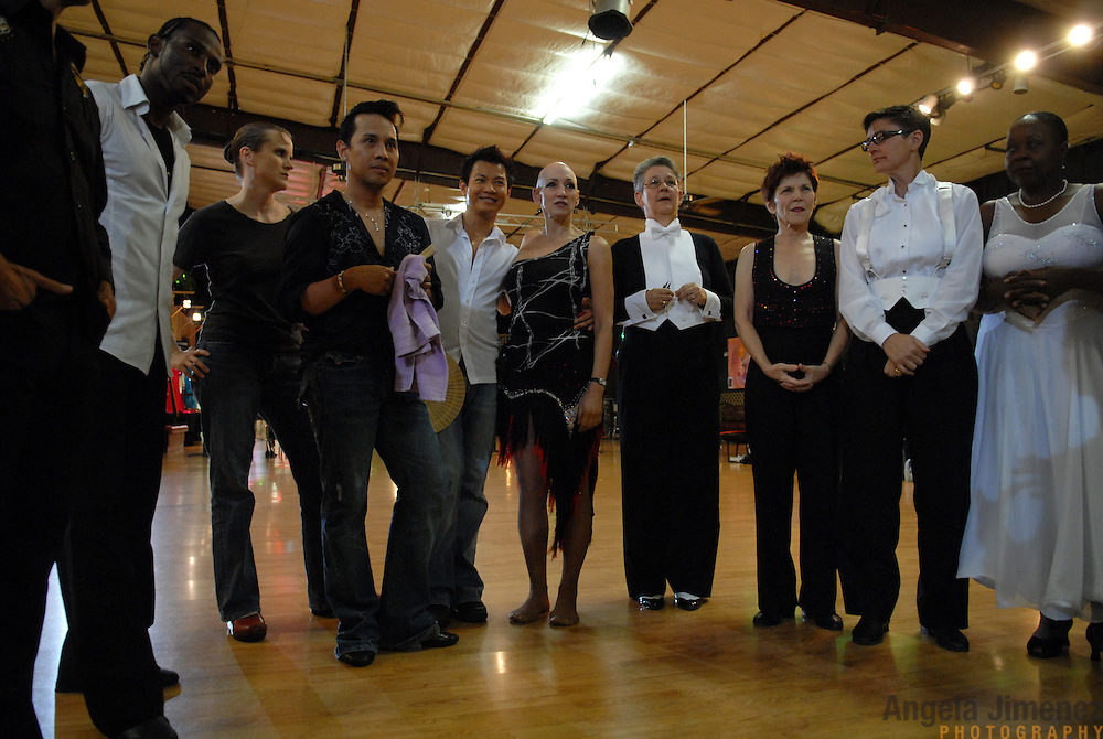 Same-sex ballroom dancers line up for a meeting the middle of the dance floor before competing at the USADSF (United States Alternative Dancesport Federation) Same-Sex Ballroom Championships at Dance Orlando in Orlando, Florida on June 2, 2007...Nine male and female couples from around the country competed in the event, which was the 3rd annual United States championship contested in this sport: the first two championships were held in Sacramento, California in 2005 and 2006. This was the first same-sex ballroom competition ever held in Florida. ..Same-sex ballroom dancing is a new sport which is growing and developing in the United States, but it has a longer history in Europe, where events have been held for over two decades.  ..