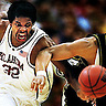 DALLAS, TEXAS - MARCH 16, 2003: Oklahoma's Jonnie Gilbert and Missouri's Travon Bryant chase after a loose ball in the Big 12 Tournament championship game. Missouri rallied from a 22-point deficit to nearly win the game, but Oklahoma held on to win the game 49-47.