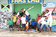 Usain Bolt with kids at Fastlaab shoot in Kingston Jamaica'10