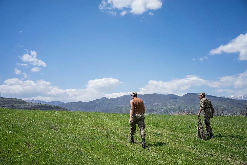 KARASHEN, NAGORNO-KARABAKH - APRIL 19: Samson Israelyan (L) and Narek Martirosyan, both 20-year-old Armenian soldiers from Spitak, prepare for a small picnic on a hill overlooking Stepanakert on April 19, 2015 in Karashen, Nagorno-Karabakh. Since signing a ceasefire in a war with Azerbaijan in 1994, Nagorno-Karabakh, officially part of Azerbaijan, has functioned as a self-declared independent republic and de facto part of Armenia, with hostilities along the line of contact between Nagorno-Karabakh and Azerbaijan occasionally flaring up and causing casualties. (Photo by Brendan Hoffman/Getty Images) *** Local Caption *** Samson Israelyan; Narek Martirosyan