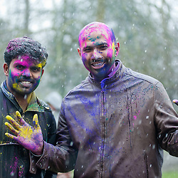 London, UK - 23 March 2013: people covered in colored powder during the Holi Spring Festival of Colour that takes place at Orleans House Gallery in Twickenham. The annual event marks the end of Winter and welcomes the joy of spring. This year it took place under heavy weather conditions.