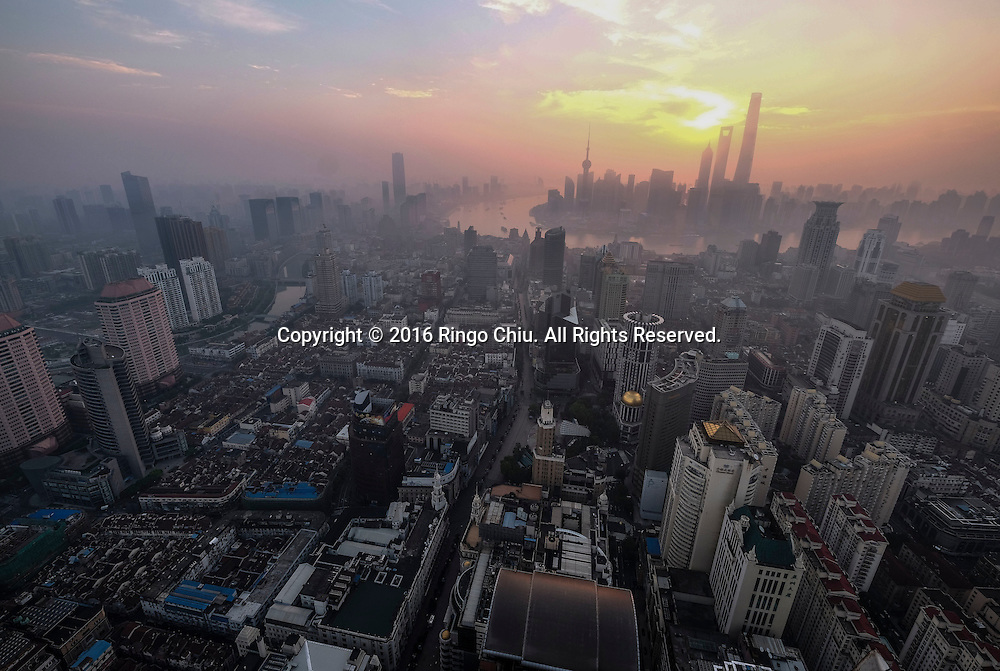 View of Shanghai with the Pudong skyline as seen at sunrise from the Meridien Hotel in Shanghai, China, Shanghai is the most populous city in China and the most populous city proper in the world. It is one of the four direct-controlled municipalities of China, with a population of more than 24 million as of 2014. It is a global financial centre, and a transport hub with the world's busiest container port. Located in the Yangtze River Delta in East China, Shanghai sits on the south edge of the mouth of the Yangtze in the middle portion of the Chinese coast. The municipality borders the provinces of Jiangsu and Zhejiang to the north, south and west, and is bounded to the east by the East China Sea. A major administrative, shipping, and trading town, Shanghai grew in importance in the 19th century due to trade and recognition of its favourable port location and economic potential. The city was one of five forced open to foreign trade following the British victory over China in the First Opium War while the subsequent 1842 Treaty of Nanking and 1844 Treaty of Whampoa allowed the establishment of the Shanghai International Settlement and the French Concession. The city then flourished as a center of commerce between China and other parts of the world (predominantly Western countries), and became the primary financial hub of the Asia-Pacific region in the 1930s. However, with the Communist Party takeover of the mainland in 1949, trade was limited to socialist countries, and the city's global influence declined. In the 1990s, the economic reforms introduced by Deng Xiaoping resulted in an intense re-development of the city, aiding the return of finance and foreign investment to the city. Shanghai has been described as the &quot;showpiece&quot; of the booming economy of mainland China; renowned for its Lujiazui skyline, museums and historic buildings, such as those along The Bund, the City God Temple and the Yu Garden.(Photo by Ringo Chiu/PHOTOFORMULA.com)<br /> <br /> Usage Notes: This content