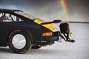Image of a black 1975 Porsche 911 streamliner with a rainbow, Bonneville Salt Flats, World of Speed 2014, Utah, American Southwest