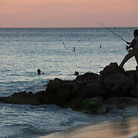 A man fishes on a beach in Aruba on September 19, 2012. Aruba, a former Dutch colony is a popular tourist destination renowned for it's Caribbean climate and pristine beaches. It is also an infamous transit port for cocaine being smuggled out of Colombia and Venezuela in route to the U.S. and Europe. (Photo/Scott Dalton)