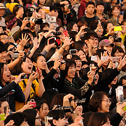 Fans at the Busan International Film Festival react to the arrival of Korean movie stars Han Hyo-joo and So Ji-sub at Haeundae Beach, Busan, South Korea, October 7, 2011.