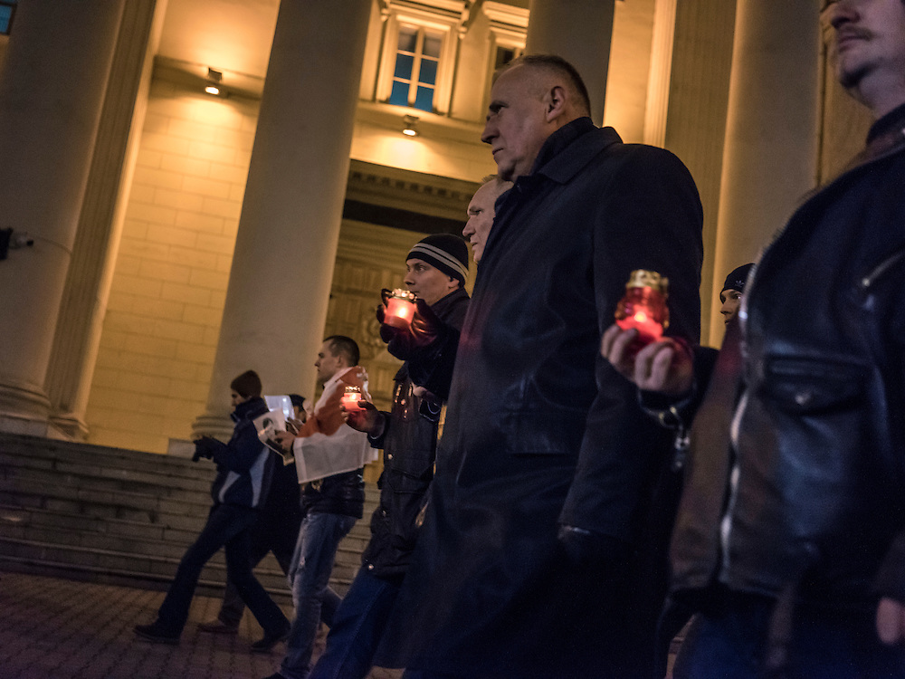Mikalai Statkevich, center, a former opposition presidential candidate and political dissident, leads a march past the KGB building to commemorate the twentieth anniversary of a referendum which enshrined authoritarian changes in Belarus's constitution on Tuesday, November 24, 2015 in Minsk, Belarus.