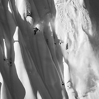 World Record holding Professional Snowboarder Mads Jonsson navigates a steep face of snowy spines during filming for Standard Films, outside of Terrace, British Columbia.