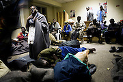 Male victims of political violence from around Zimbabwe seek refuge at Harvest House in central Harare Zimbabwe. Up to 700 men, women and children were seeking refuge at the HQ of the rival political party, MDC after fleeing rural and more recently urban areas around the capitol city Harare. ..Earlier in the day, the HQ received a tip of that a raid by ZanuPF/Police was imminent. Most fled the HQ in expectation of the raid which occurred at midday, resulting in the arrest of 60 persons and internment at local police station. ..With night time temperatures dropping to 5-6deg celsius many of the victims and IDP have little alternative but to return to the MDC HQ to seek shelter,warmth and food at night.