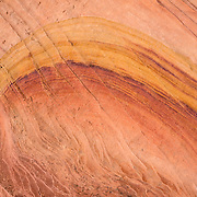Explore colorful fossilized sand dunes in the Paw Hole section of South Coyote Buttes, in Vermilion Cliffs National Monument, Arizona, USA. The Coyote Buttes area exposes cross-bedded aeolian Jurassic Navajo Sandstone. Various iron oxides bled through the sandstone layers to create a salmon color; hematite and goethite added yellows, oranges, browns, and purples. For the required hiking permit, contact the US Bureau of Land Management (BLM, in Kanab, Utah). Access to this Federal public land is regulated to protect fragile geologic formations. Coyote Buttes are within Vermilion Cliffs National Monument (established in 2000 within Arizona), which is within Paria Canyon-Vermilion Cliffs Wilderness Area (established in 1984 spanning across the borders of Utah and Arizona).