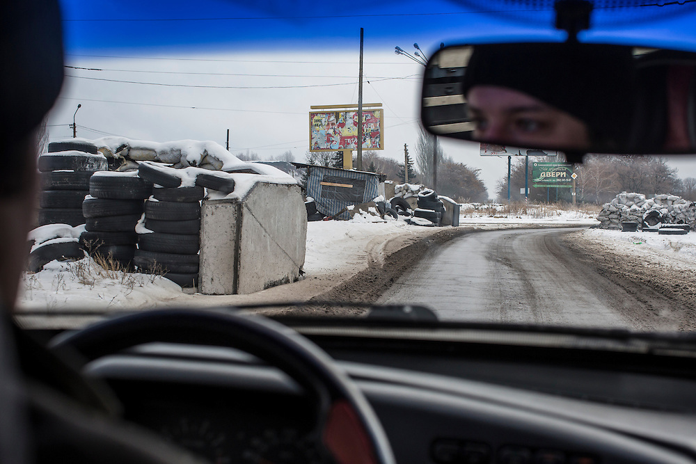 MAKIIVKA, UKRAINE - DECEMBER 8, 2014: An abandoned checkpoint on the road heading east from Donetsk, in Makiivka, Ukraine. CREDIT: Brendan Hoffman for The New York Times