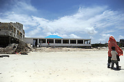 """The """"Lido seafood and tourism"""" restaurant at he beach in the outskirts of Mogadishu,Somalia. are being rebuild by owner Kasim Mohammed. Once finished he is sure that the tourists will start coming again. He is hopeing for a peaceful country in the future and have a strong belief bebuilding the destroyed areas of the city."""
