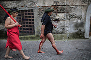 A Battente followed by a man reppresenting Christ on the medieval streets of Nocera Terinese