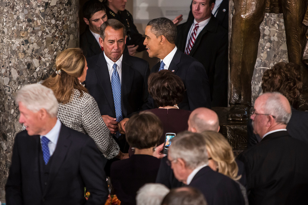 House Speaker John Boehner (R-OH) and President Barack Obama speak at the Inaugural Luncheon in Statuary Hall at the U.S. Capitol on Monday, January 21, 2013 in Washington, DC.