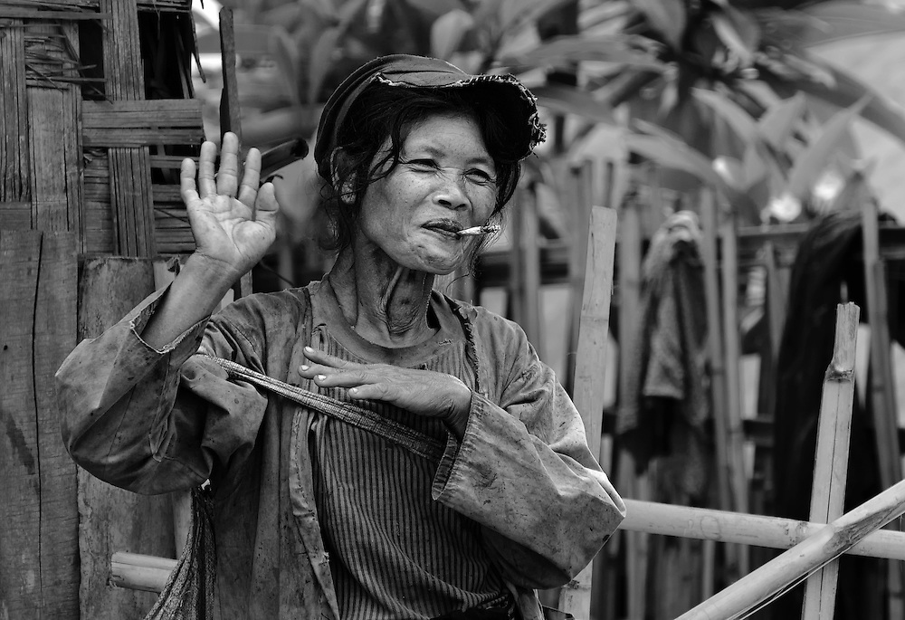 A woman finds having her photo taken hillarious near Luang Prabang, Laos.