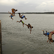 Boys jump into the sea in São José do Ribamar, Maranhão state, Brazil.