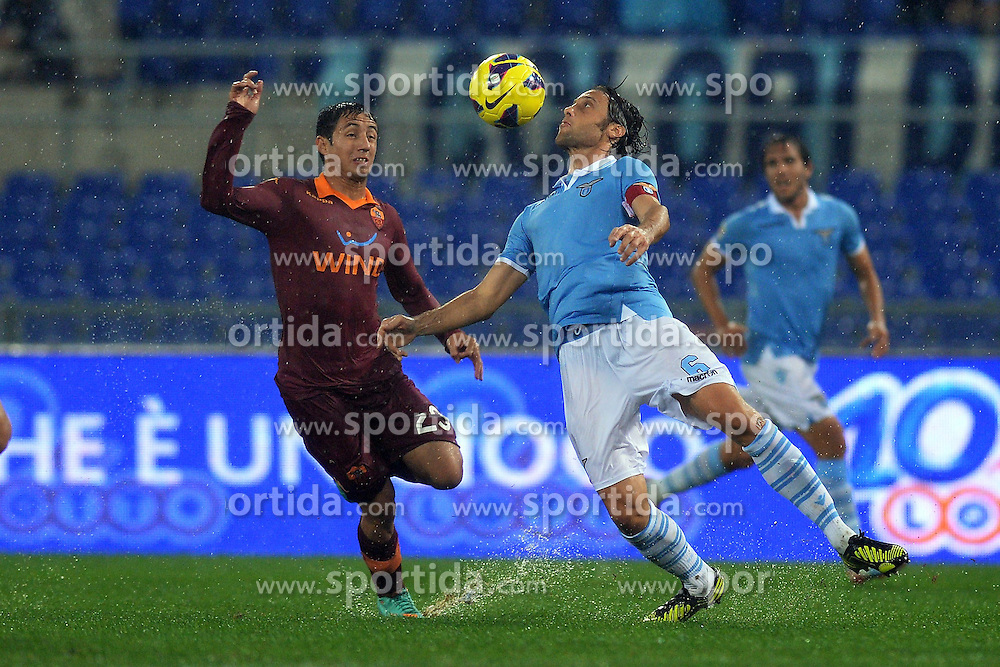 11.11.2012, Olympiastadion, Rom, ITA, Serie A, Lazio Rom vs AS Rom, 12. Runde, im Bild Ivan Piris Roma, Stefano Mauri Lazio // during the Italian Serie A 12th round match between SS Lazio and AS Roma at the Olympic Stadium, Rome, Italy on 2012/11/11. EXPA Pictures © 2012, PhotoCredit: EXPA/ Insidefoto/ Andrea Staccioli..***** ATTENTION - for AUT, SLO, CRO, SRB, SUI and SWE only *****