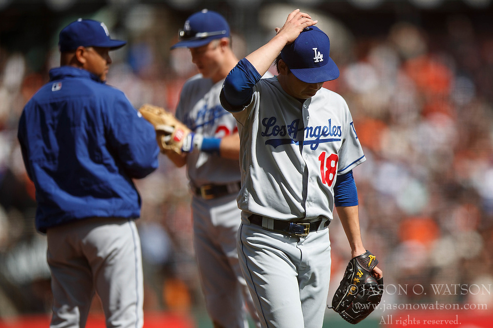 SAN FRANCISCO, CA - OCTOBER 02: Kenta Maeda #18 of the Los Angeles Dodgers returned to the dugout after being relieved against the San Francisco Giants during the third inning at AT&T Park on October 2, 2016 in San Francisco, California. The San Francisco Giants defeated the Los Angeles Dodgers 7-1. (Photo by Jason O. Watson/Getty Images) *** Local Caption *** Kenta Maeda