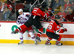 April 9, 2008; Newark, NJ, USA;  New York Rangers left wing Martin Straka (82) gets hit by New Jersey Devils defenseman Colin White (5) during the first period of game 1 of the Eastern Conference Quarterfinal playoffs at the Prudential Center in Newark, NJ.