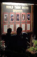 Washingtonville, N.Y. - An adult and two children look at the Washingtonville 5 Firefighters World Trade Center Memorial on Sept. 11, 2006. The Memorial was built in honor of five FDNY firefighters from Washingtonville and the many others who lost their lives on September 11, 2001 in the World Trade Center terrorist attack. The Memorial was built in honor of five local firemen and the many others who lost their lives on September 11, 2001 in the World Trade Center terrorist attack.<br />