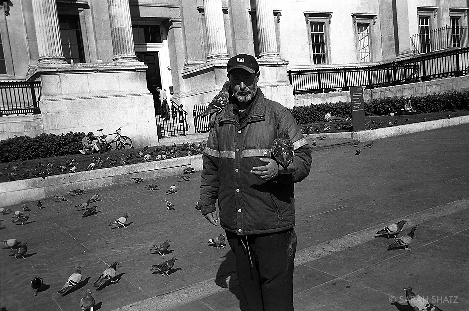 Man with birds at the National Gallery