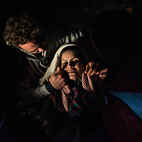 A woman suffering ipothermia is helped by local volunteers moments after landing on the Greek shores of Lesbos FEDERICO SCOPPA/CAPTA