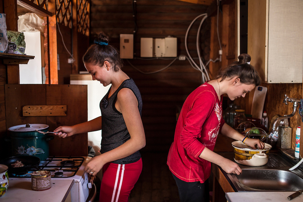 A group of internally displaced people who fled the besieged city of Donetsk cook in the communal kitchen in the small seaside resort that has become their home on Tuesday, October 14, 2014 in Berdyansk, Ukraine. Photo by Brendan Hoffman, Freelance
